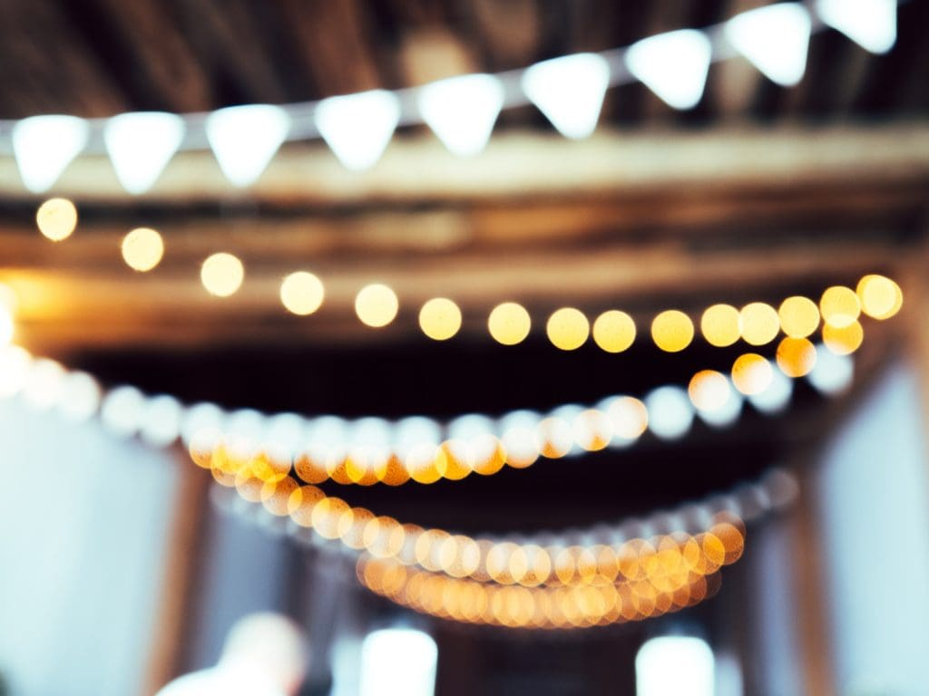 blurry lights at a wedding, wedding insurance tips